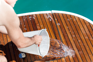 Man Washing The Deck